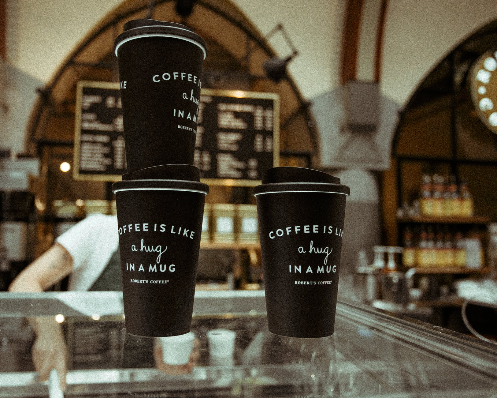 disposable black and white plastic coffee cups